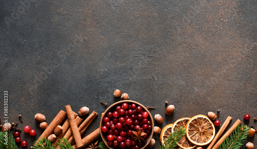 Fototapeta Christmas decoration with punch ingredients: cranberry, cinnamon and spices