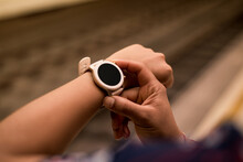 Close Up Image Of Young Woman Checking The Smartwatch Device On The Underground. Railway On The Background.