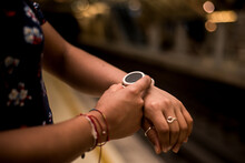Close Up Photography Of Young Woman Using Smart Watch On The Subway Station.