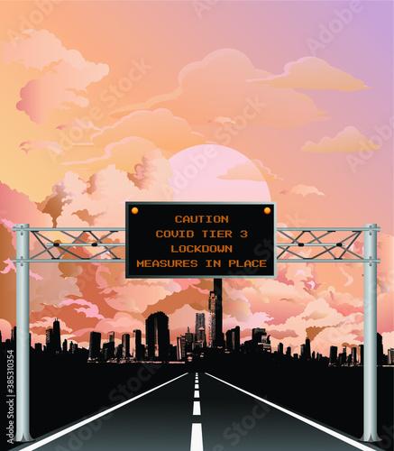 Obraz Roadway gantry sign with COVID tier three Coronavirus lockdown message set against a stunning dawn or dusk cloudy sky  - fototapety do salonu