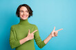 Leinwandbild Motiv Portrait of positive cheerful girl promoter point index finger copyspace demonstrate adverts promo recommend suggest select wear jumper isolated over blue color background