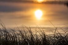 Rising Sun Reflects In Calm Wa...
