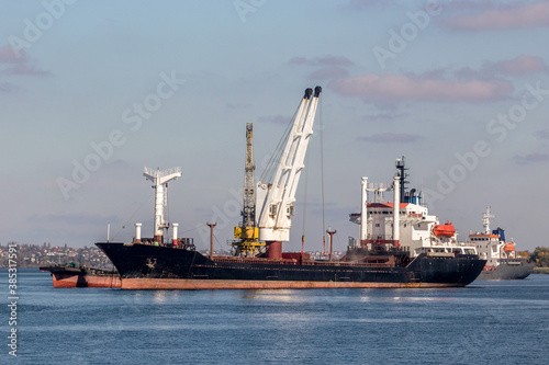 Fototapeta large dry cargo ship on the roadstead of the Dnieper river