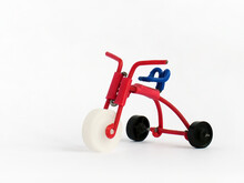 Miniature Model Of Kids Bicycle On White Background. Icon Of Old-style Bike. Handmade