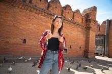 Asian Woman Traveling At Tha P...