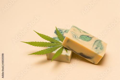 Homemade hemp soap and green leaf of marijuana. Spa organic soap. Organic skincare product with medicinal CBD. Zero waste concept