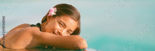 Obraz na plátně Resort vacation wellness pampering Asian young woman happy relaxing in pool panoramic banner