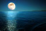 Fototapeta Fototapety z morzem do Twojej sypialni - Full moon with reflections on a calm sea at midnight.