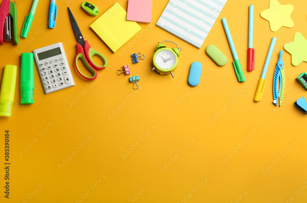 Fototapeta School stationery on yellow background, flat lay with space for text. Back to school