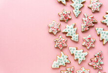 Homemade Christmas Gingerbread Cookies In The Shape Of Stars And Trees On A Pink Background, Space For Text