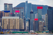 Panoramic View Of Hongkong Central Or Hong Kong Skyline With Modern And Urban Decay Skyscrapers And Buildings And Victoria Harbor Bay With Ships And Marine Traffic With Waterfront Promenade