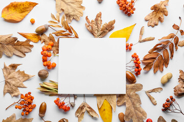 Fototapeta Boks Beautiful autumn composition with empty card on white background