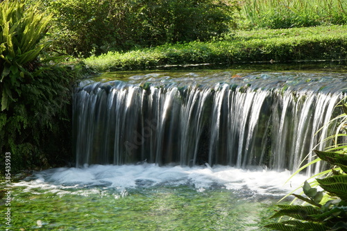 Fototapety, obrazy: Small artificial waterfall in the Ninfa Garden in Italy