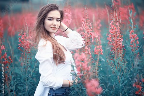 pink flowers hairgirl model / beautiful glamorous fashion model in the field nature summer