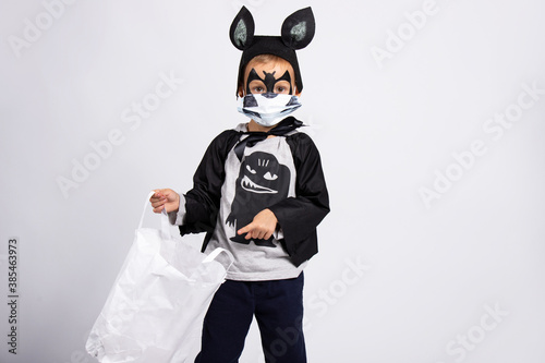 Canvas Kid trick or treat in Halloween costume and face mask