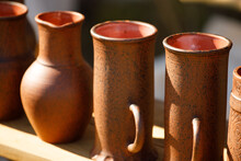 Brown Clay Mugs Are On The She...