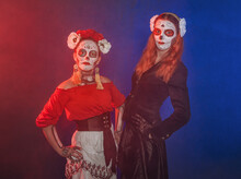 Two Beautiful Woman With Scary Halloween Make Up Dead Day Calavera Style
