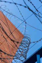 Generic Prison Wall With Concertinas And Barbed Wire