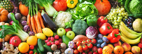 Fototapeta Panoramic food background with assortment of fresh organic fruits and vegetables obraz