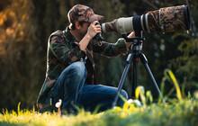Wildlife Photographer Using Te...