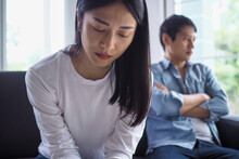 Asian Women Are Disappointed And Saddened After An Argument With Their Husband. Asian Couples Are Having Family Problems Resulting In Divorce. Love Problem