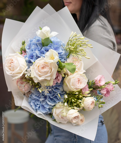 Colorful flowers assorted bouquet in paper. Holiday celebration concept. Bouquet of beautiful flowers in hands. Work of florist. © Liudmyla