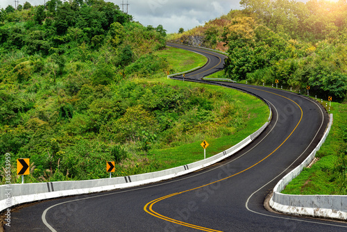 Fototapeta Road no.3 or sky road over top of mountains with green jungle in Nan province, Thailand. obraz