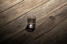 Shot Glass With Vodka On A Old...