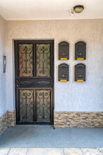 Vintage Entrance In House With Door And Mailboxes