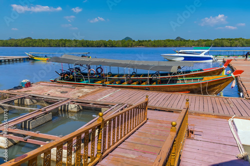 Fototapeta Landing stage for boats visiting the settlement built on stilts of Ko Panyi in P