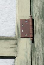 Rusty Hinge On An Old Door Detail