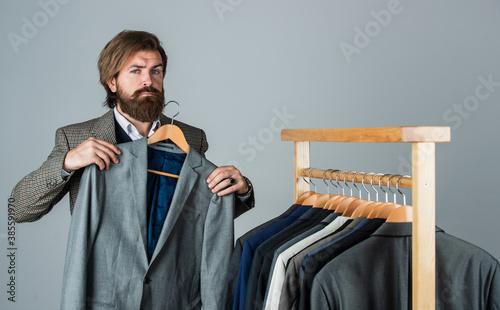 Fashioner man designing formal clothes premium quality, classic wardrobe concept