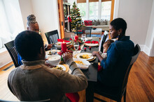 Black Multigenerational Family Eating Christmas Holiday Meal