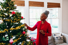 Senior Black Woman Decorating ...