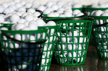 Baskets Of Range Balls At The Driving Range On A Golf Course