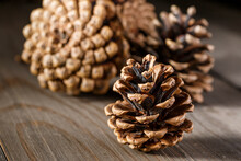 Pine Cones On Wooden Background.Rustic Natural Wooden Background With Pine Cones