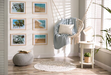 Stylish Room Interior With Artworks And Hanging Chair