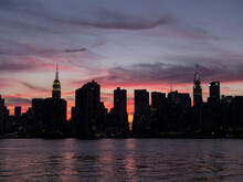 New York City Skyline View Of Midtown Manhattan Across The East River From Long Island City, Queens At Sunset.