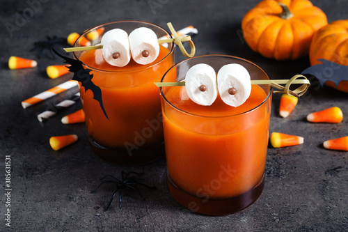 Obraz Decorated glasses with drinks on grey table. Halloween celebration - fototapety do salonu