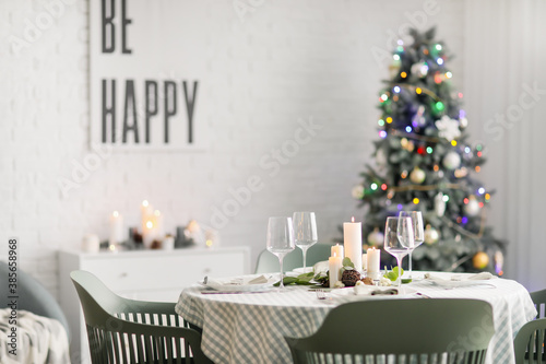Fototapeta Interior of room with table set for Christmas dinner