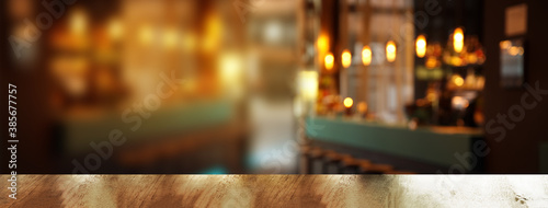 Fototapeta top of wood table with blur light in pub or bar night party banner background obraz