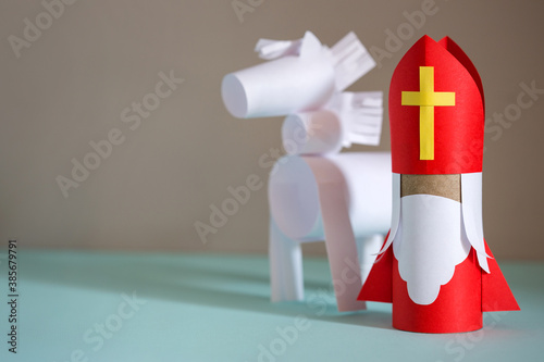 paper craft for kids. DIY toy Saint Nicholas and white horse for sinterklaas day. create art for children. Netherlands Santa Claus.