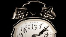 Distorted Retro Alarm Clock With Black Background