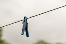 Clothespin Hanging From A Rope...