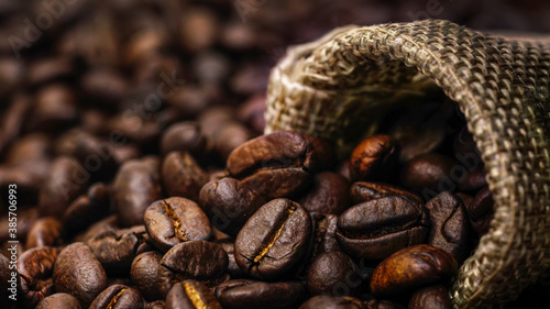 Fotografering Coffee Beans in a sack bag.