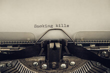 Typing A Warning Slogan Smokin...