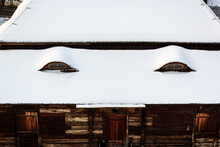 Old Log Cabin Covered With Sno...