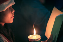 A Children Singer Caroler Hands Holding Candle And Book With Singing Carol Song On Celebration Of Christmas Day Background