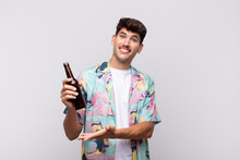 Young Man With A Beer Smiling ...
