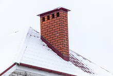 Brick Chimney In The Snow On T...
